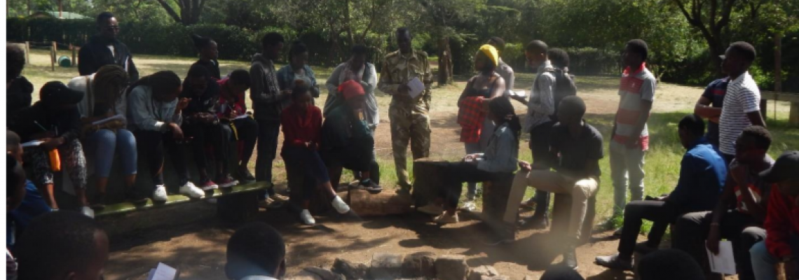 Students conducting a key informant interview in Oldonyo Sabuk National Park with KWS officer.
